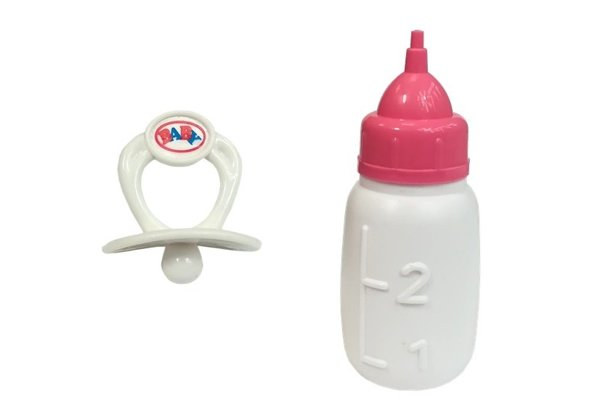 Baby Doll with a pacifier and bottle of milk